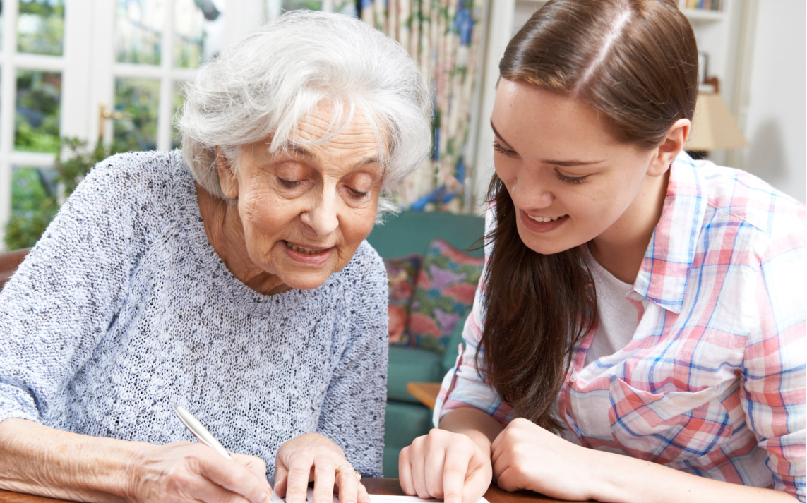 nursing assistant talking with a senior woman