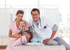 nursing assistants taking care of a child