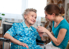 nursing assistant talking to an elder woman